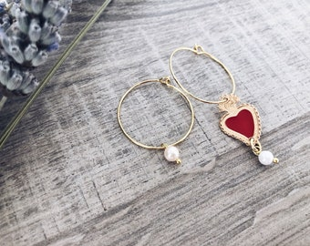 Brass hoop earrings with enamelled votive pendant and bead