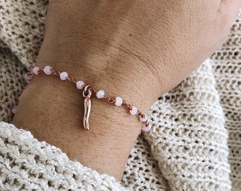 Bracelet with rosary chain and rosé brass croissant pendant