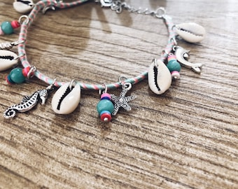 Anklets in fabric with shells and sea-themed charms
