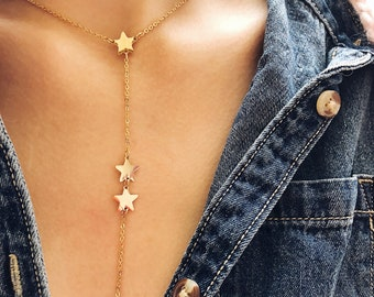 Long necklace in gold steel with stars