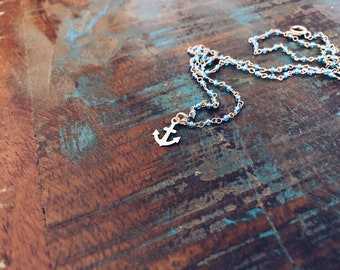 Necklace with rosary chain with beads and brass anchor pendant