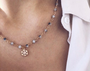 Rosary chain necklace with faceted blue crystals and snowflake pendant