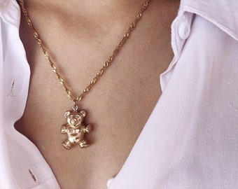 Necklaces with golden steel chain and vintage teddy bear pendant