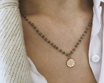 Necklace with chain with mini crystals and polar star pendant with zircons