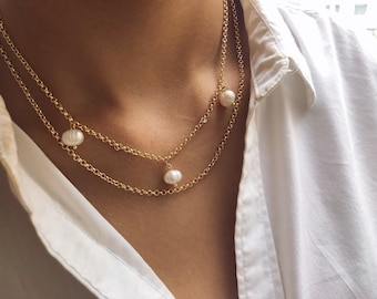 Double-strand necklace with gold-plated brass chain and river beads