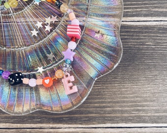 Necklace with resin beads and colored initial