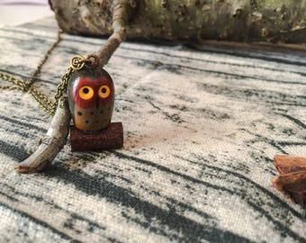 Long bronze necklace with owl pendant in wood