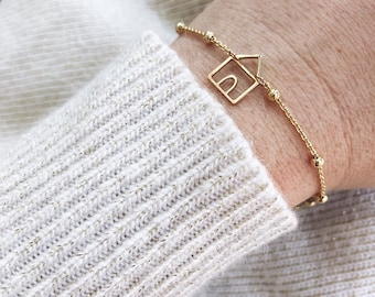Limited Edition - Bracelet entirely in 18k gold and 18k gold with a small house pendant