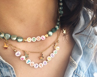 Necklace with colored beads, hearts or stars and colorful letters