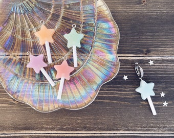 Mono hoop earrings with zircons and colored resin pendants