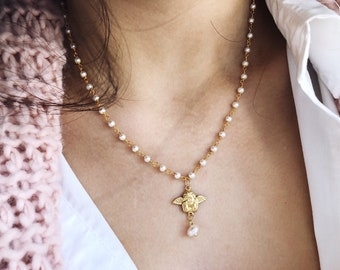Necklace with rosary brass chain with white beads and amorino pendant
