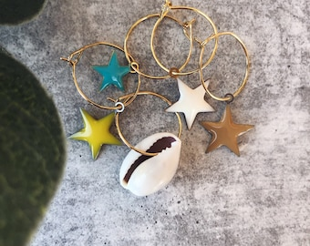 Brass hoop earrings with shell and enameled stars