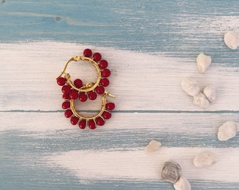 Circles earrings in golden steel and coral