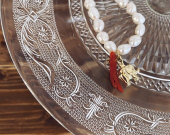 Necklace with freshwater pearls and elephant and natural coral pendants