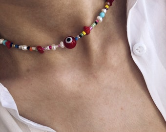 Choker necklace with multicolor beads, river pearls, coral sprigs and Greek glass eye