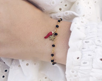 Bracelet with rosary brass chain with beads and horned pendant and starlet