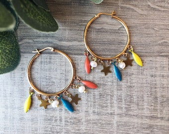 Brass hoop earrings with enamelled sardine pendants, beads and little stars