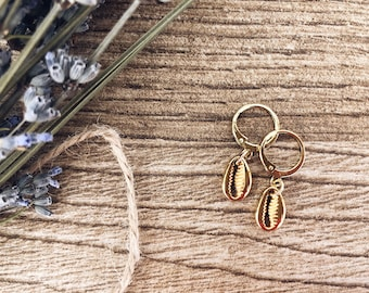Mini golden brass hoop earrings with gold-plated mini shell pendant