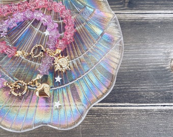 Bracelets with stars in glittery resin and 925 gold plated silver pendant