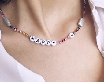 Necklace with mini multicolor beads, rectangular pearls and letters to compose