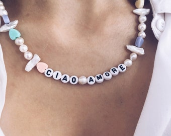 Choker necklace with natural pearls in various shapes, resin hearts and letters to compose