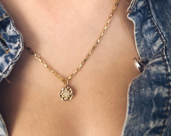 Necklaces with golden steel chain and brass pendant with central crystal