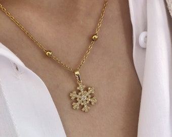 Necklace with chain with steel beads and a snowflake pendant with cubic zirconia