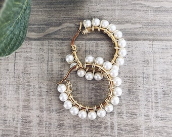 Golden steel hoop earrings with pearls - large size