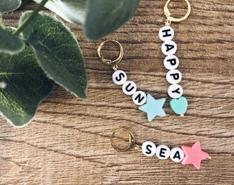 Mono mini hoops earrings in golden brass with letters, stars and hearts in colored resin