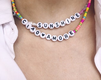 Necklace with mini multicolor fluo beads, smile in polymer clay and letters to compose