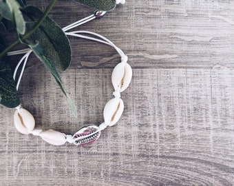 Anklet in white rope with shells in silver brass