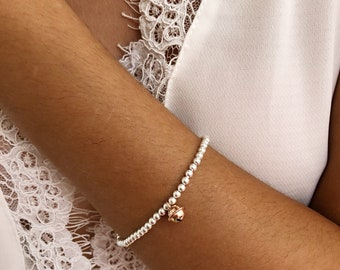 Bracelet entirely made of 925 silver with beads and bell pendant