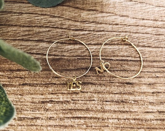 Gold-plated brass hoop earrings with small brass pendants