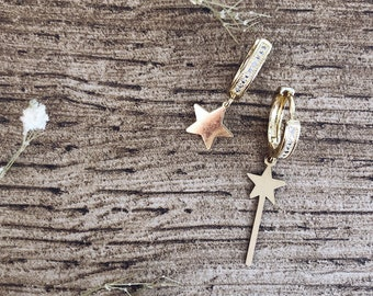 Silver hoop earrings with zircons and magic wand and star charms