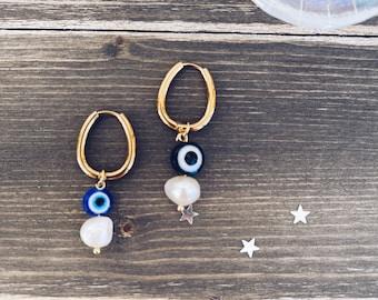 Mono steel earrings with river pearl and resin greek eye