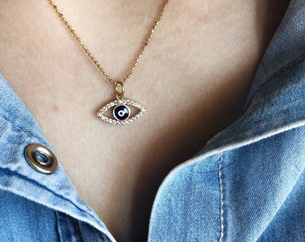 Necklace with chain in gilded silver and greek eye pendant in brass with cubic zirconia