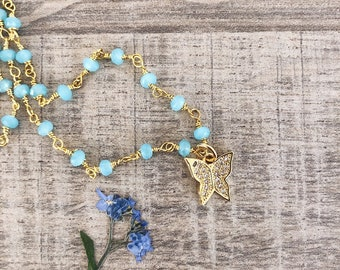 Necklace with rosary chain and brass butterfly pendant with cubic zirconia
