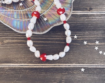 Necklace with freshwater pearls and red glass mushrooms