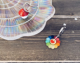 Mono earring with zircons and resin pendant