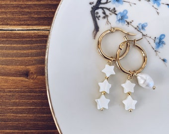 Hoop earrings in gilded steel with mother-of-pearl and river pearl stars