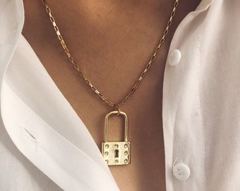 Necklaces with golden steel chain and brass bolt pendant
