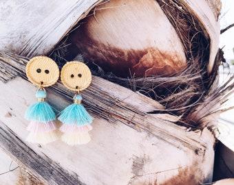 Brass hoop earrings with cotton tassels