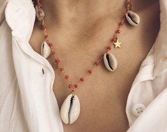 Multicharm necklace with rosary chain, shell and stars