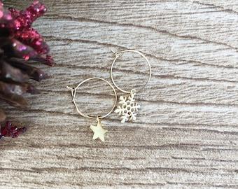 Brass hoop earrings with snowflake and star pendants
