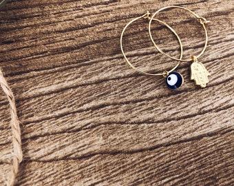 Brass hoop earrings with blue Greek eye pendant and hand of Fatima