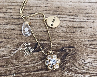 Dream - Long necklace with raw brass chain and vintage pendants
