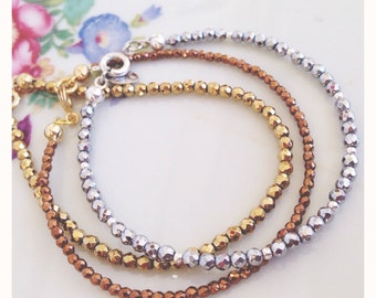 Bracelets in three colors of gold in authentic hematite