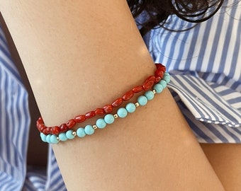 Bracelets with turquoise and coral paste beads and 925 gilded silver clasps