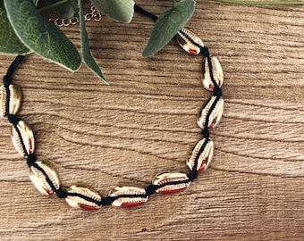 Croker necklace with black rope and gold enameled brass shells