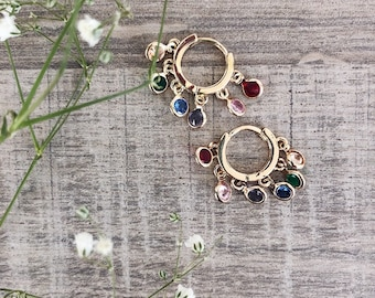 Hoop earrings with small crystalline colored pendants